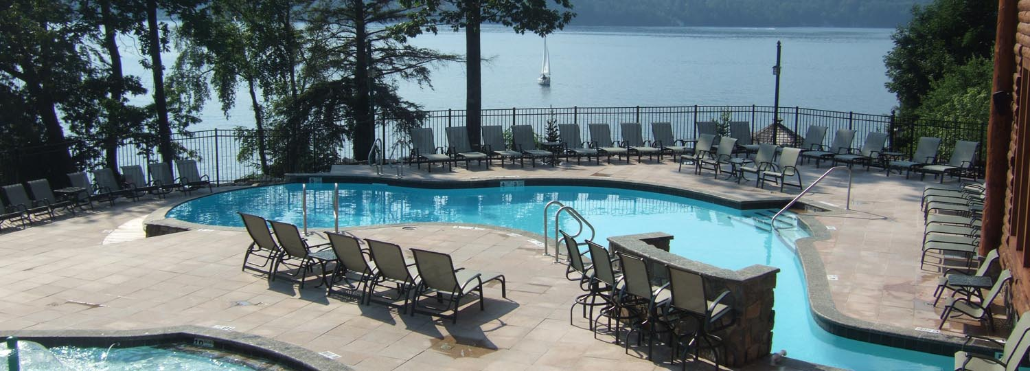 Outdoor pool area near lake.