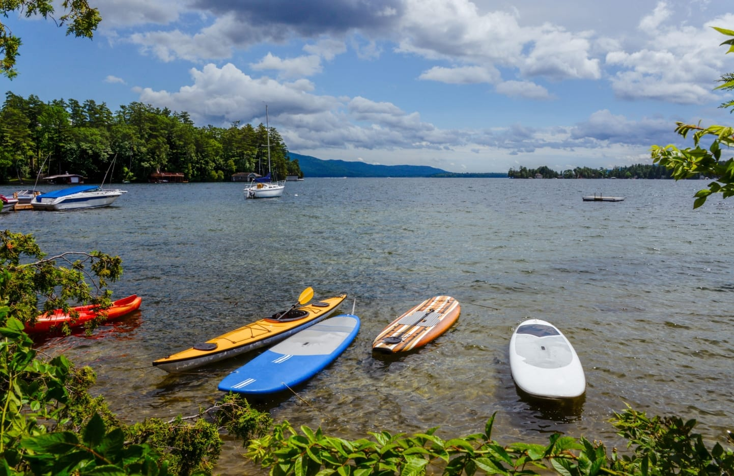 Kayaks sitting near shore of Lake George.